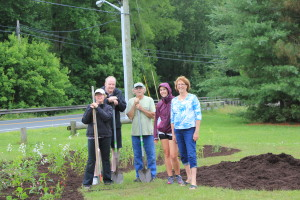Volunteers install a pollinator garden at Adkins Mill Nature Park